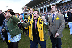Racegoers celebrate during St Patrick's Thursday of the 2018 Cheltenham Festival at Cheltenham Racecourse. PRESS ASSOCIATION Photo. Picture date: Thursday March 15, 2018. See PA story RACING Cheltenham. Photo credit should read: Mike Egerton/PA Wire. RESTRICTIONS: Editorial Use only, commercial use is subject to prior permission from The Jockey Club/Cheltenham Racecourse.