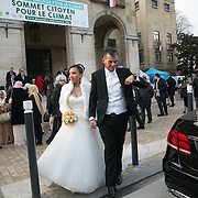 A newly wed couple comes out of the Montreuil town hall.Citizen Climate Summit in Montreuil. A host of organisations, small NGOs, political art events and food stalls set the scene for discussions and debates on climate change as an alternative to the offical COP21 in Bourget.  The official climate talks in Paris is on and the pressure to come up with a sustainable legally binding is high. In the aftermath of recent terrorist attacks public demonstrations have been banned during the 2 weeks of climate talks