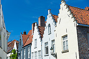Traditional architecture painted houses with crow-stepped gables - crow steps -  in Bruges - Brugge - Belgium