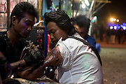 Tattooing during the Taunggyi Ballon Festival Fair, in Taunggyi, Myanmar.<br /> Note: These images are not distributed or sold in Portugal