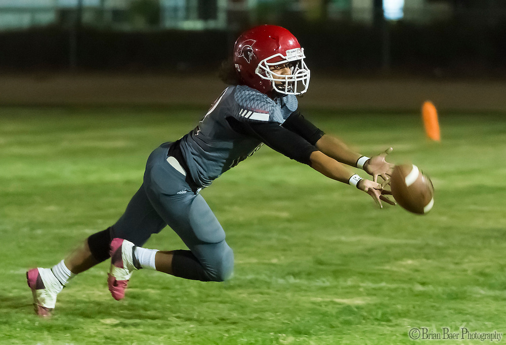 San Juan Spartans Tongo Lomano (12), misses a pass intended for him during the fourth quarter as the San Juan Spartans host the Mira Loma Matadors, Friday Sep 16, 2016.<br /> photo by Brian Baer