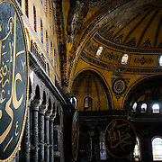 Massive calligraphy medallions in Aya Sofya with the names of Allah, the Prophet Muhammad, the first four caliphs Abu Bakr, Umar, Uthman and Ali, and the two grandchildren of Mohammed: Hassan and Hussain, by the calligrapher Kazasker İzzed Effendi (1801–1877). Originally built as a Christian cathedral, then converted to a Muslim mosque in the 15th century, and now a museum (since 1935), the Hagia Sophia is one of the oldest and grandest buildings in Istanbul. For a thousand years, it was the largest cathedral in the world and is regarded as the crowning achievemen of Byzantine architecture.