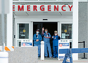 HYANNIS - Healthcare workers wave to their well-wishers in the Cape Cod Hospital parking lot on Friday, April 10, 2020.