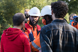 An anti-HS2 activist (l) asks an HS2 security guard (c) to return an item which he pocketed belonging to a fellow activist during tree felling works alongside HOAC lake in connection with the HS2 high-speed rail link on 21 September 2020 in Harefield, United Kingdom. Anti-HS2 activists continue to try to prevent or delay works for the controversial £106bn HS2 high-speed rail link on environmental and cost grounds from a series of protection camps based along the route of the line between London and Birmingham.