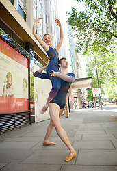 New English Ballet Theatre <br /> publicity shoot 8th June 2014 <br /> for their upcoming programme <br /> Tryst: Devotion and Betrayal<br /> 2nd -  5th July 2014 at the <br /> Peacock Theatre, London, Great Britain <br /> <br /> Royal Ballet Soloist & Choreographer Valentino Zucchetti will be premiering Orbital Motion with music by Philip Glass as part of a five bill programme. <br /> <br /> Ludovico Di Ubaldo and Mercedes Schindler - both in costume outside the Peacock Theatre in Holborn.  <br /> <br /> Valentino is also pictured with his partner and NEBT dancer Mercedes Schindler who will perform in Orbital Motion.