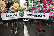London, UK. Sunday 29th November 2015. Peoples March for Climate Justice and Jobs demonstration. Demonstrators gathered in their tens of thousands to protest against all kinds of environmental issues such as fracking, clean air, and alternative energies, prior to Major climate change talks. Placards calling for 100% clean energy.