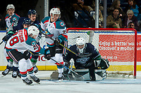 KELOWNA, CANADA - FEBRUARY 23:  Leif Mattson #28 of the Kelowna Rockets takes a shot on the net of Dorrin Luding #35 of the Seattle Thunderbirds on February 23, 2018 at Prospera Place in Kelowna, British Columbia, Canada.  (Photo by Marissa Baecker/Shoot the Breeze)  *** Local Caption ***