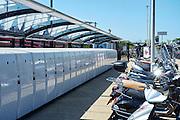 Fietskluizen en scooters bij treinstation Sassenheim - Cycle lockers and scooters near trainstation Sassenheim, The Netherlands