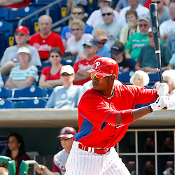 February 24, 2011; Clearwater, FL, USA; Philadelphia Phillies right fielder Domonic Brown (9) at bat during a spring training exhibition game against Florida State University at Bright House Networks Field. Mandatory Credit: Derick E. Hingle
