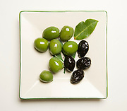 Plump green Castelvetrano olives and black dry-cured olives have very different flavor profiles.
