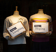 Positive messages during Covid coronavirus lockdown held by mannequins in shop window, UK - Keep Laughing, Keep Hoping
