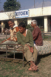 Women with disabilities sitting on a bed in the grounds of the Apahaj Ashram at Patiala; Punjab; India,