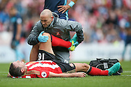 Sunderland defender John O'Shea (16) gets treatment before going off injured during the Premier League match between Sunderland and Middlesbrough at the Stadium Of Light, Sunderland, England on 21 August 2016. Photo by Simon Davies.