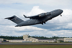 A C-17 Globemaster III with the 176th Wing takes off during the Arctic Thunder Open House Special Needs and Department of Defense Family Day at Joint Base Elmendorf-Richardson, Alaska, June 29, 2018. During the biennial open house, the base opens its gates to the public and hosts multiple performers including the U.S. Air Force Thunderbirds, JB Elmendorf-Richardson Joint Forces Demonstration and the U.S. Air Force F-22 Raptor Demonstration Team. (U.S. Air Force photo by Alejandro Peña)