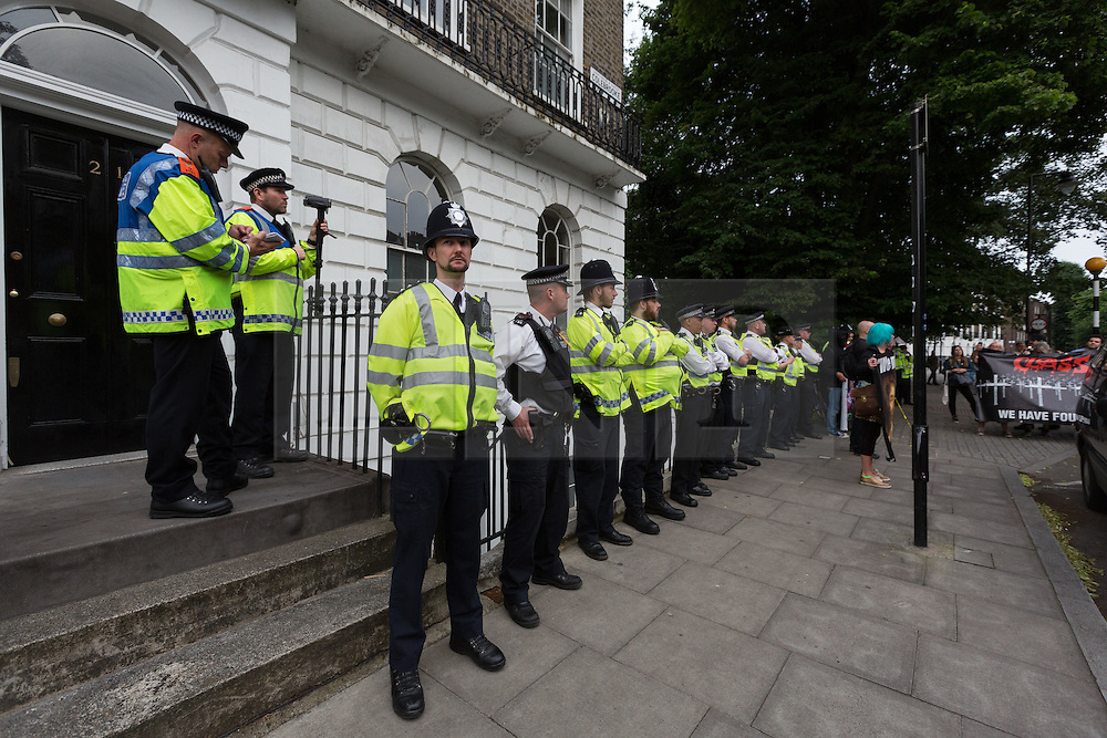 © Licensed to London News Pictures. 15/07/2016. LONDON, UK. Police outside Boris Johnson's house. Demonstrators from Class War stage a protest outside Foreign Secretary, Boris Johnson's house in north London against Boris Johnson's appointment as Foreign secretary, claiming he is racist.  Scuffles broke out between a passer by who supported Boris Johnson, protesters and police. Photo credit: Vickie Flores/LNP
