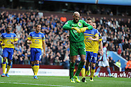 Everton keeper Tim Howard celebrates after he saves a 1st half penalty taken by Villa's Christian Benteke. Barclays Premier League, Aston Villa v Everton at Villa Park in Aston, Birmingham on Saturday 26th Oct 2013. pic by Andrew Orchard, Andrew Orchard sports photography,