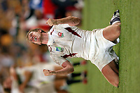 Photo: Richard Lane.<br />Australia v England. Rugby World Cup Final, at the Telstra Stadium, Sydney. RWC 2003. 22/11/2003. <br />Will Greenwood celebrates victory over Australia to win the Rugby World Cup.