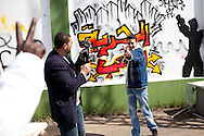 Youth film a music video in Benghazi on March 1, 2011.