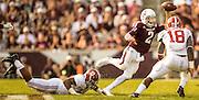 Sep 14, 2013; College Station, TX, USA; Texas A&M Aggies quarterback Johnny Manziel (2) scrambles against Alabama Crimson Tide linebacker Reggie Ragland (18) and linebacker Jonathan Allen (93) during the second half at Kyle Field. Mandatory Credit: Thomas Campbell-USA TODAY Sports