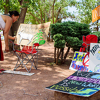 Nadine Narindankura sets up protest signs outside the Navajo Department of Education in Window Rock Monday.