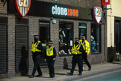© Licensed to London News Pictures. 12/04/2021. Manchester, UK. Officers on patrol are seen outside a branch of Clone Zone . People on a night out in Manchester City Centre as government restrictions to control the spread of Coronavirus are eased across the UK. Pubs, restaurants, hairdressers, gyms and non essential retailers are now permitted to serve customers within restrictions. Photo credit: Joel Goodman/LNP
