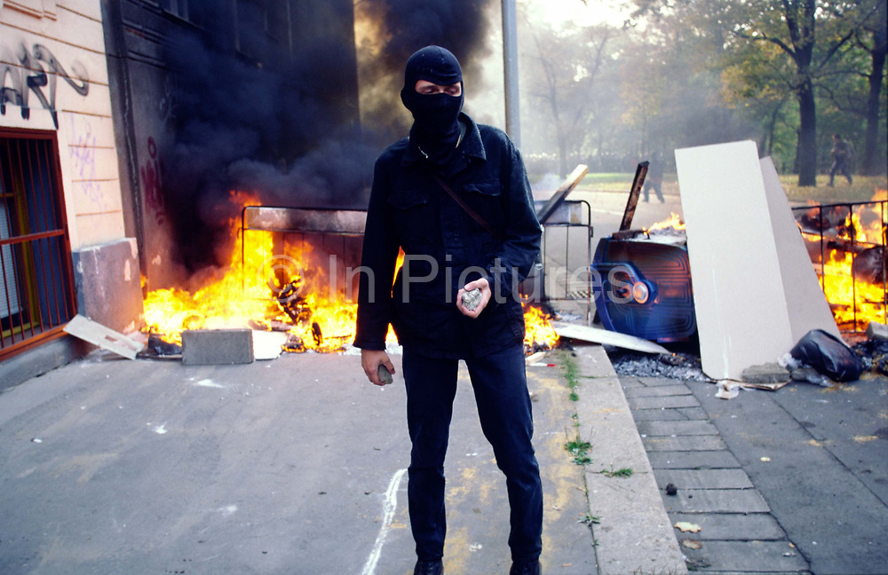 Protester beside a burning barracade during the Anti Globalisation riots Prague, Czech Republic