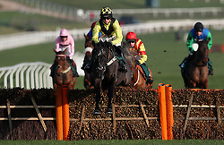 """Elixir De Nutz ridden by Harry Cobden on their way to victory in the British Stallion Studs EBF """"National Hunt"""" Novices' Hurdle during day one of the International Meeting at Cheltenham Racecourse."""