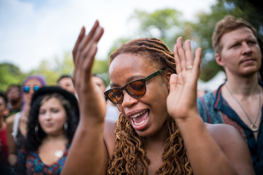 BROOKLYN, NY - AUGUST 23, 2015: Heather McGhee and friend Jāmin Gilbert, behind her to the right, at Afropunk Festival at Commodore Barry Park in Brooklyn. CREDIT: Emon Hassan for The New York Times