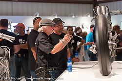 Willie G. Davidson and son Bill Davidson check out Max Hazan's bike in the Naked Truth exhibition at the Buffalo Chip gallery during the 75th Annual Sturgis Black Hills Motorcycle Rally.  SD, USA.  August 5, 2015.  Photography ©2015 Michael Lichter.