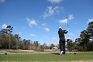 WILMINGTON, NC - MARCH 19: UNC Wilmington's Reese McFarlane tees off on the Ocean Course sixth hole. The first round of the 2017 Seahawk Intercollegiate Men's Golf Tournament was held on March 19, 2017, at the Country Club of Landover Nicklaus Course in Wilmington, NC.