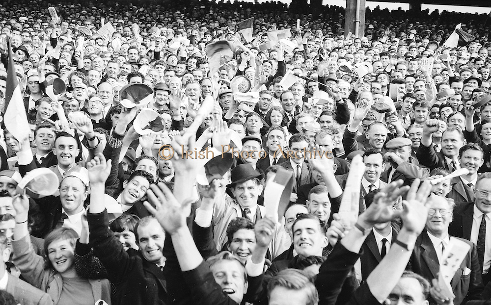 Wild supporters all set for a hectic game at the Kerry v. Galway All Ireland Senior Gaelic Football Final, 26th September 1965. Galway 0-12 Kerry 0-09.