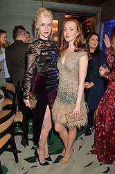 Left to right, PORTIA FREEMAN and OLIVIA GRANT at a dinner hosted by Creme de la Mer to celebrate the launch of Genaissance de la Mer The Serum Essence held at Sexy Fish, Berkeley Square, London on 21st January 2016.