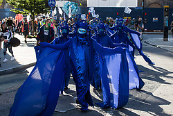London, UK. 6th September, 2020. The blue rebels join fellow climate activists from the Ocean Rebellion and Extinction Rebellion at a colourful Marine Extinction March. The activists, who are attending a series of September Rebellion protests around the UK, are demanding environmental protections for the oceans and calling for an end to global governmental inaction to save the seas.