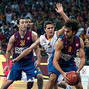 Galatasaray's Jaka LAKOVIC (C) and FC Barcelona Regal's Chuck EIDSON (L), Victor SADA (R) during their Euroleague group D matchday 5 Galatasaray between  FC Barcelona Regal at the Abdi Ipekci Arena in Istanbul at Turkey on Thursday, November 17 2011. Photo by TURKPIX
