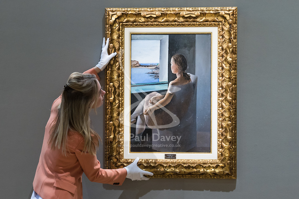 Bonhams, London, February 27th 2017. A member of Bonhams staff adjusts Salvador Dali's 'Figura de perfil', which is expected to fetch between £800,0000 and £1,200,000, at the Bonhams impressionist and modern art sale press preview at their Mayfair gallery in London.