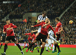 17 December 2016 - Premier League - West Bromwich Albion v Manchester United - Jonas Olsson of West Bromwich Albion wins header a a corner from Zlatan Ibrahimovic of Manchester United - Photo: Paul Roberts / Offside.