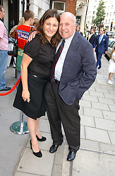 YVONNE MICHAEL and ELLIOTT KASTNER at a private view of artist Damian Elwes work 'Artists Studios' held at Scream, 34 Bruton Street, London W1 on 29th June 2006.<br />