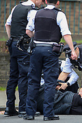 Police restraint and arrest a man in south London on Sunday, May 2, 2021. Compared to the national crime rate, South East London's crime rate is at 104%. Violent crime makes up 20.4% of all crimes reported in the postcode area.  The borough with the highest rate of crime per person remains Westminster with 192.8 crimes for every 1,000 people, second-highest is Kensington and Chelsea (112.7 per 1,000 people) and third Camden (117 per 1,000 people). (Photo/ Vudi Xhymshiti)