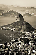 Sugarloaf Mountain, or Pão de Açúcar is a granite monolith that stands 396 m (1,299 ft) above the Guanabara Bay harbor in Rio de Janeiro. Apparently given this name in the 16th century by the Portuguese sugar traders who shipped their sugar in conical moulds very similar in shape. Iconic and well worth the cable car trip to the summit ( pausing to find Jaws from James Bond / Moonraker )