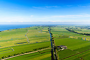 Nederland, Noord-Holland, Gemeente Edam-Volendam, 13-06-2017; Polder Zeevang met Zeevangse Zeedijk, IJsselmeerdijk ten noorden van Edam (aan de horizon.<br /> De dijk staat op de nominatie om verstrekt te worden, bewoners en actievoerders vrezen aantasting van de monumentale dijk en verlies culturele waarden.<br /> Zeevangse Zeedijk (seawall) north of Edam.<br /> The dike is nominated to be reinforced, residents and activists fear losing the monumental quality of the dike and losing other cultural values.<br /> <br /> luchtfoto (toeslag op standaard tarieven);<br /> aerial photo (additional fee required);<br /> copyright foto/photo Siebe Swart