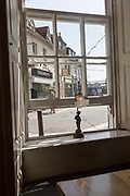 View from pub window of historic buildings in Poole Harbour, Poole, Dorset, England, UK
