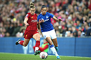 Liverpool women defender Becky Jane (22) tackles Everton women forward Chantelle Boye-Hlorkah (7) during the FA Women's Super League match between Liverpool Women and Everton Women at Anfield, Liverpool, England on 17 November 2019.
