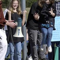 Olga Doroshenko, 11, left and Shayla Drake, 11, react to their solar car winning the race at Ed White Elementary School, 03/08/04.   (Photo by Kim Christensen)