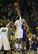 December 07 2010: Iowa Hawkeyes forward Melsahn Basabe (1) and Northern Iowa Panthers forward Jake Koch (20) battle for the tipoff during the first half of their NCAA basketball game at Carver-Hawkeye Arena in Iowa City, Iowa on December 7, 2010. Iowa defeated Northern Iowa 51-39.