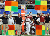 Oklahoma Sooners coaching staff call plays during the 77th AT&T Cotton Bowl Classic between the Texas A&M University Aggies and the Oklahoma University Sooners at Cowboys Stadium in Arlington, Texas. Texas A&M wins the 77th AT&T Cotton Bowl Classic against Oklahoma, 41-13.