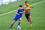 AFC Wimbledon defender Will Nightingale (5) battles with Hull City forward Mallik Wilks (7) during the EFL Sky Bet League 1 match between AFC Wimbledon and Hull City at Plough Lane, London, United Kingdom on 27 February 2021.