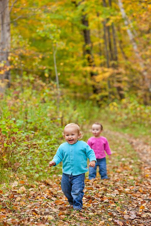 Two young girls on a trail on Millstone Hill in Barre, Vermont. Millstone Trail Association.