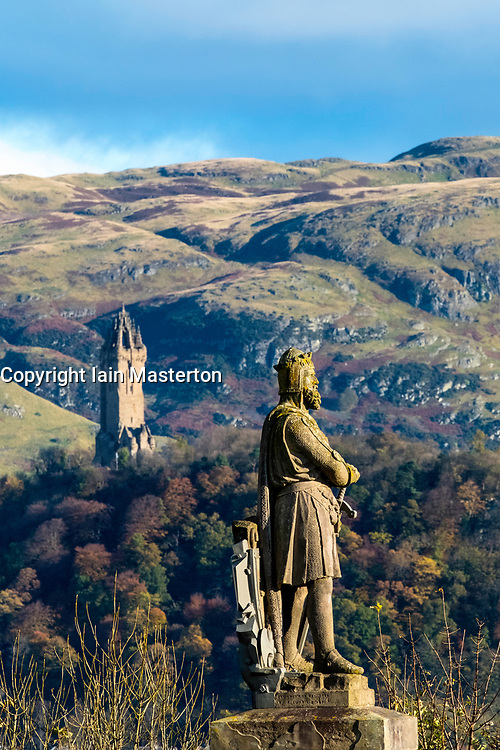 Statue of Robert the Bruce at Stirling Castle and Wallace Monument in distance  , Stirlingshire, Scotland, United Kingdom.