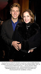 Top ballerina DARCEY BUSSELL and her husband MR ANGUS FORBES, at a party in London on 13th December 2000.OKF 30