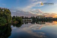 Buildings reflect in the Spokane River at Riverfront Park in Spokane, Washington, USA